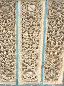 Decorative carved panels on a wall at the Alcazar.
